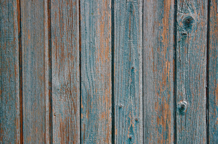 Wooden background from vertical old boards with shabby paint