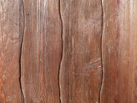 Abstract wooden background of brown color from vertical planks of irregular shape. Stock Photo