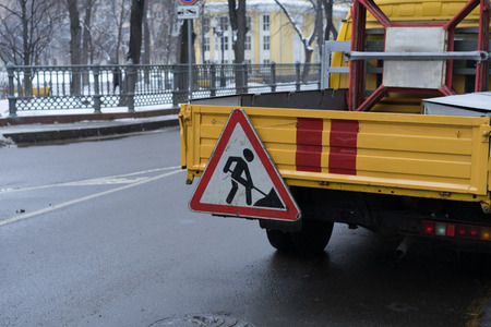 roadsigns: Roadsigns on the urban asphalt road. Men at work Stock Photo