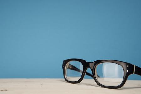 Black glasses on a blue background