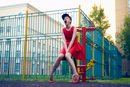 chic woman: the girl in the red dress screams