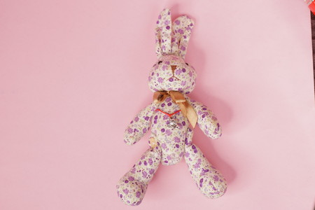 soft toy plush pink Bunny on a pink background