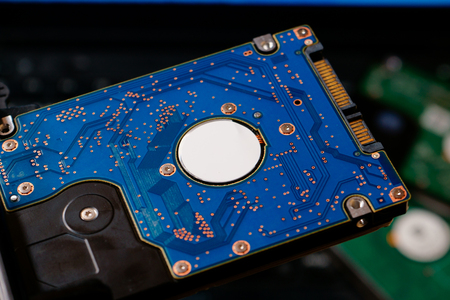Hard drive from laptop. Computer Repair. Technical service of laptops. Stack of hard disk drive with copy space for text. Stock Photo
