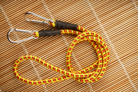 Two carabiners on a climbing rope background showing hiking safety equipment great for extreme sports shops