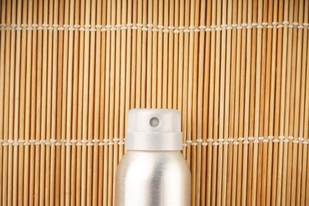 Balon deodorant antiperspirant on wooden background