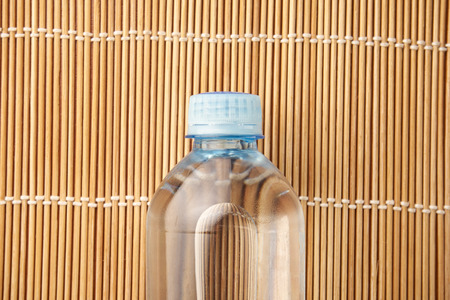 bottle of mineral water on wooden background