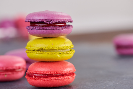 l French macaroons on a dark table