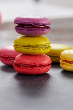French macaroons on a dark table Standard-Bild
