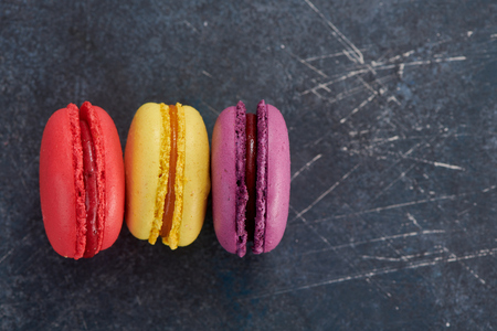 French macaroons on a dark table 스톡 콘텐츠