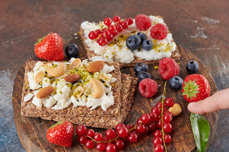 Sandwich with nuts and berrie Useful breakfast.