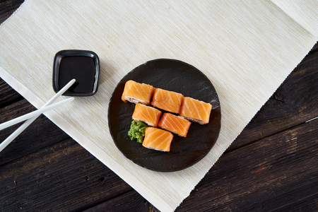 Sushi in a row on a black plate 스톡 콘텐츠