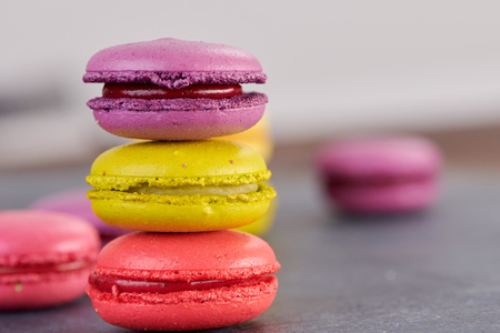 French macaroons on a dark table Stock fotó