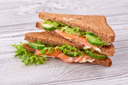 fish sandwich on white wooden background