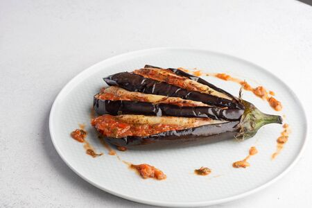 aubergine appetizer with tomato sauce Imagens