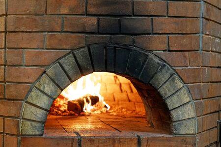 wood-burning oven with burning wood