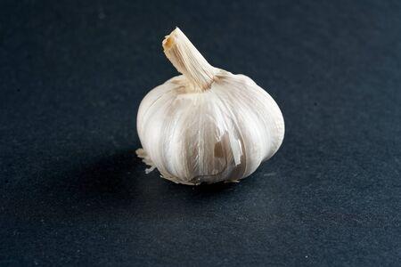 one head of garlic on a black background Reklamní fotografie