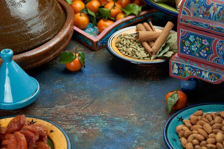 Bulgur porridge in a painted Eastern plate in the center of the table Mandarin dried apricots Eastern cuisine
