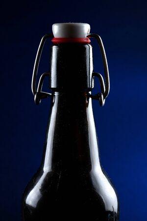 beer bottle with lid dark glass on a dark background Reklamní fotografie
