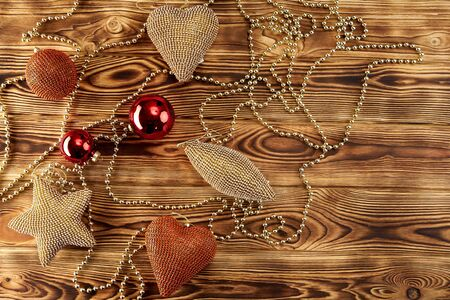 Christmas garland on a wooden background hearts stars