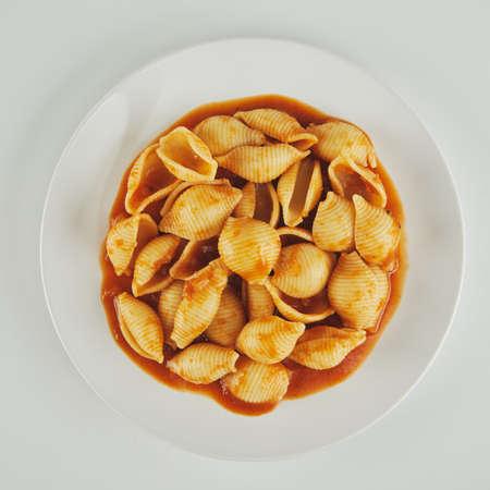 pasta on a white plate with tomato sauce Reklamní fotografie
