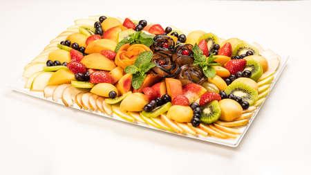 beautiful fruit bouquet apples kiwi currants strawberries mint on a tray
