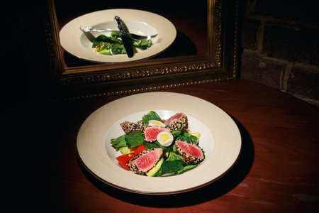 tuna salad with beetroot egg salad leaves on a plate with a knife and fork in a restaurant Reklamní fotografie