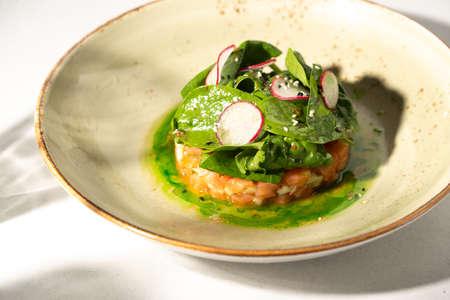 Salmon salad with radish pieces salad with lemon and olive oil sauce