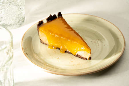 Cheesecake cottage cheese dessert cake pie casserole with apricot jam on a plate