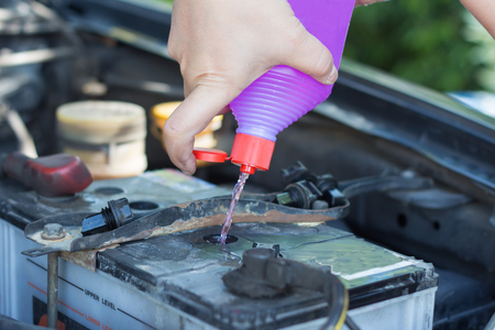 Fill distilled water in the battery