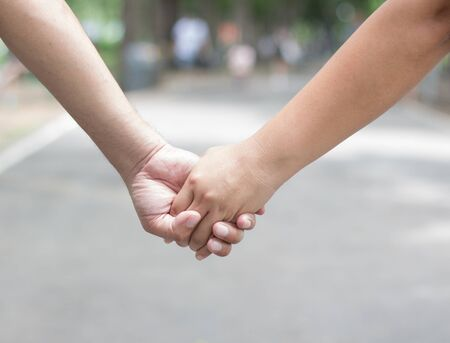 Couple lover holding hands together