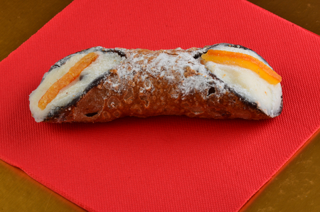 Dessert: Cannolo Siciliano . In a italian restaurant. Фото со стока