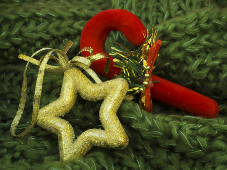 gold flax: Christmas decoration on green wool Stock Photo