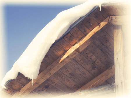 cedar shakes: Snow covered roof. Winter cottage