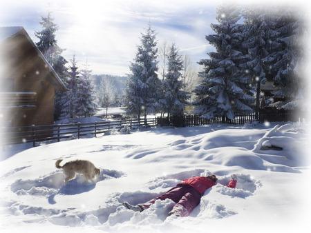 Divertimento invernale. Giovane donna che giocano nella neve. Angelo Di neve Archivio Fotografico - 51734687