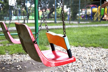 Children swing set on the playground