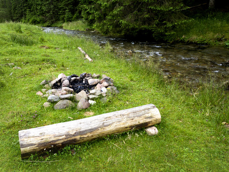 selfmade: Self-made campfire by the mountain river Stock Photo