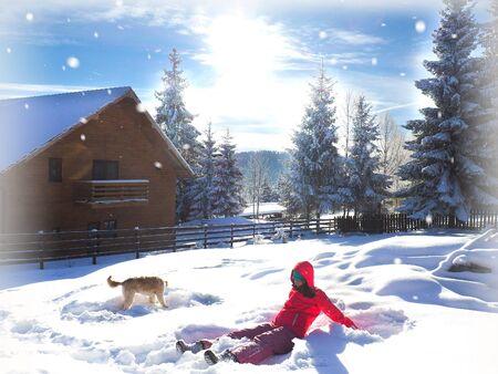 Winter girl making a snow angel