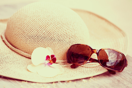bathe: Summer vacation concept with straw hat Stock Photo
