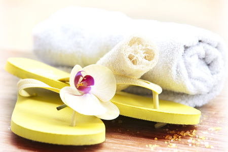 Beach day, yellow slippers and natural sponge spa concept Stock Photo
