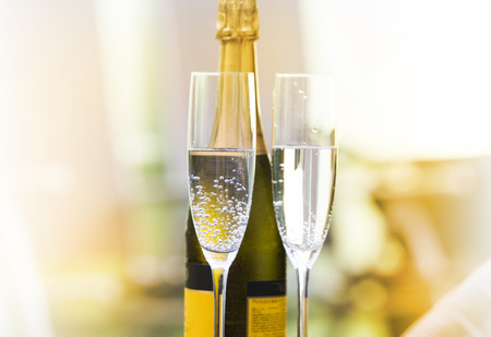 Vintage champagne glasses background. New Year garden party