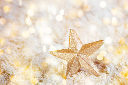 Golden sparkle star decoration for Christmas and New Year bokeh background