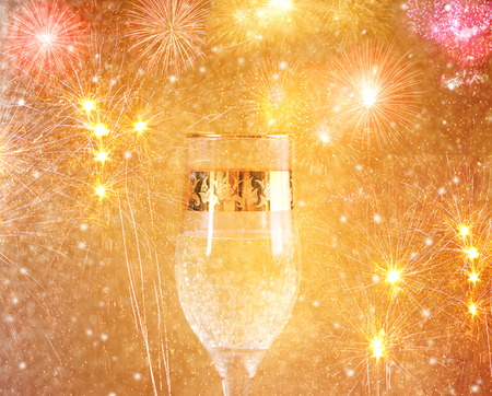 Champagne glasses and fireworks. New Year background