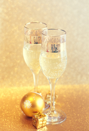 New Year golden champagne glasses background Stock Photo