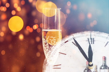 Champagne glasses and midnight clock. Happy New Year