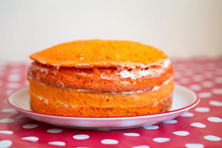 Orange homemade cake prepared for icing and fondant Stock Photo