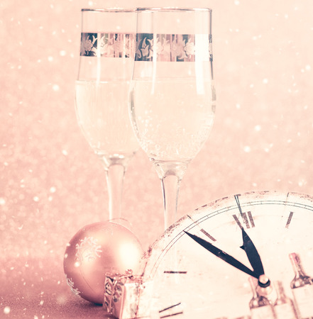 Winter background with New Year Champagne glasses