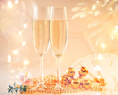 New Year Champagne glasses and fireworks background