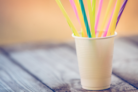 Plastic free concept, plastic straws on wooden background