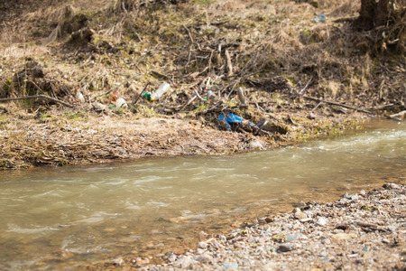 River plastic pollution, plastic waste in water Imagens