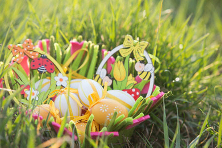 Easter eggs in a basket in the grass
